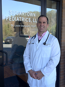 Dr. Giangiulio in front of his Sugartown Pediatrics office